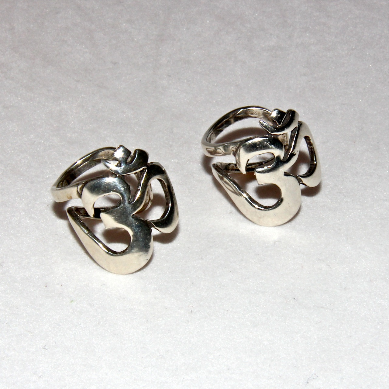 bold silver om ring honoring the sacred